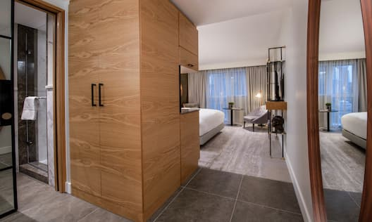 King Guestroom with Bed, Lounge Area, and Room Technology