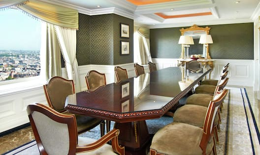 Presidential Suite Dining Room With Table and Chairs