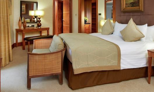 Bed in Suite With Chair