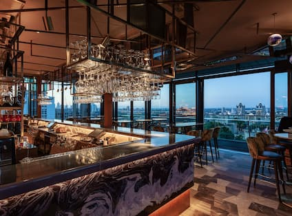 Savage Garden Bar Area with View of the City