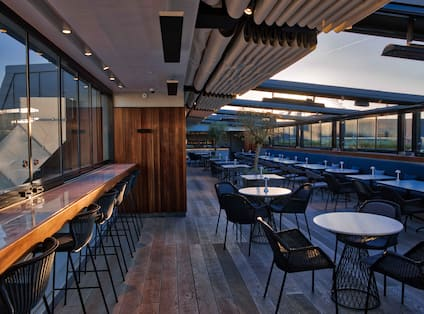 The Rooftop restaurant with open ceiling at sunset