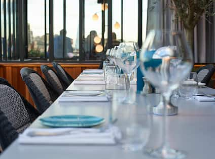 Close-up of dining table with amenities