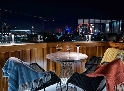 Rooftop bar with view of city at night