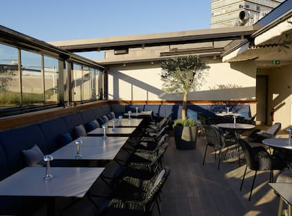 Rooftop restaurant private event dining area with open ceiling