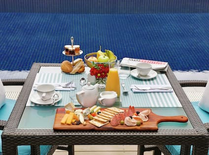 Breakfast Table Setting Next To Pool