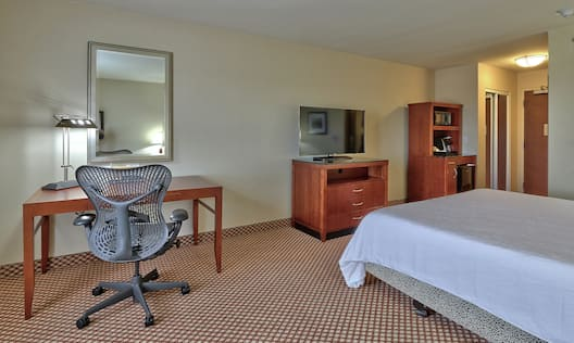 Single King Guestroom with Work Desk and Amenities