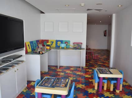 Kids Corner with Colorful Floor Desks and Chairs
