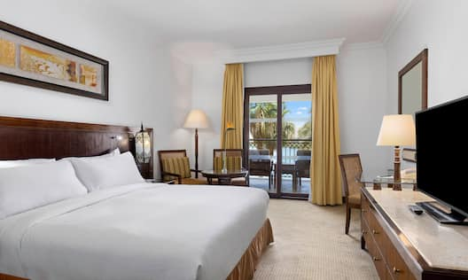 Overview of Deluxe King Room with HDTV Desk Area and Balcony with River Views