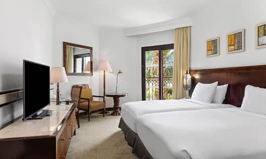 Two Beds in Guest Room with HDTV and Partial View of the River Nile