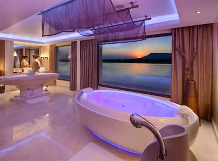 Spa Area with Tub and Large Windows at Sunset
