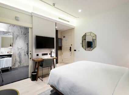 King Bed, Bathroom View, TV, Work Desk and Wall Mirror in Accessible Room