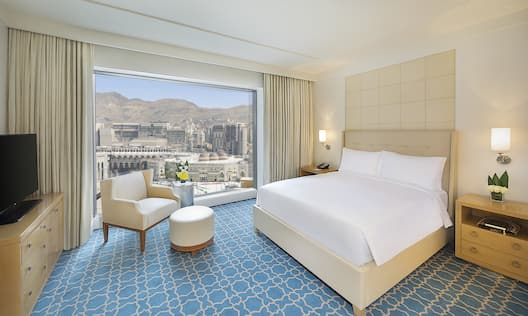 King Executive Suite Bedroom with HDTV and City View
