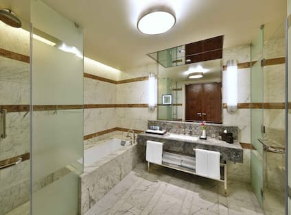 Grand Premier Suite Bathroom with Bathtub and Walk-In Shower