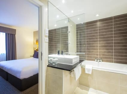 King Family Junior Suite Bathroom and Bedroom
