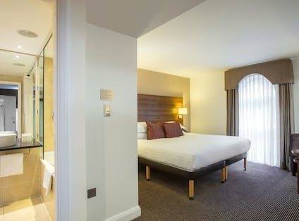 Accessible Suite with Bed and Adjacent Bathroom
