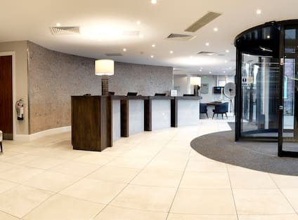 Front Desk Reception Area with Front Entrance Revolving Doors