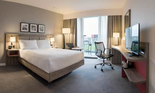 One King Bed Accessible Guest Room with HDTV, Work Desk and View of Soccer Field
