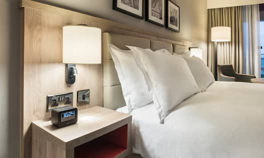 One King Bed  with Bedside Table, Lamp and Alarm Clock