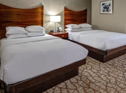 two queen beds in a hotel room