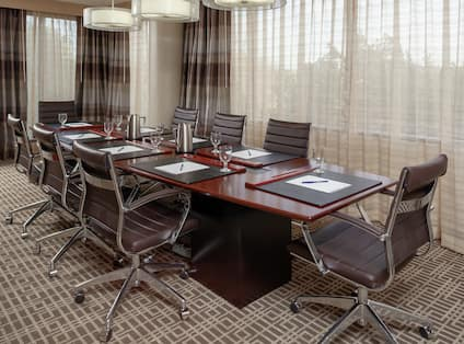 a meeting table and chairs in a room