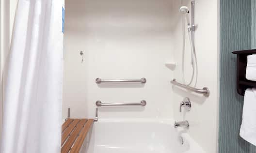 Accessible Guest Room Bathroom with Tub and Bench Seat