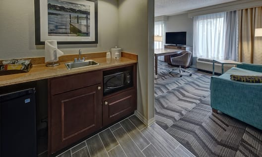 Guest Room Wet Bar with Sink, Refrigerator, Microwave Oven and View of Lounge Area
