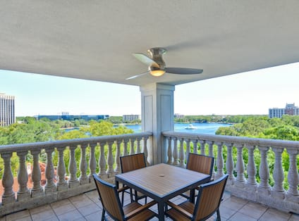 Presidential Suite Balcony with Table, Chairs and Fan