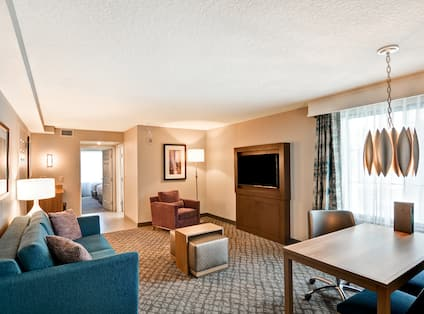 Accessible Suite Living Room with Lounge Seating, Table and Television