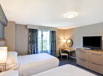 Double Suite Bedroom with Two Double Beds, Work Desk, Television and Outside View