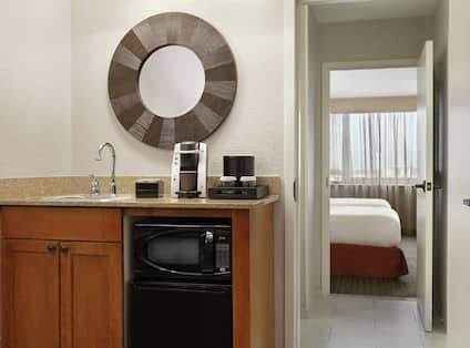 Wetbar in room with microwave