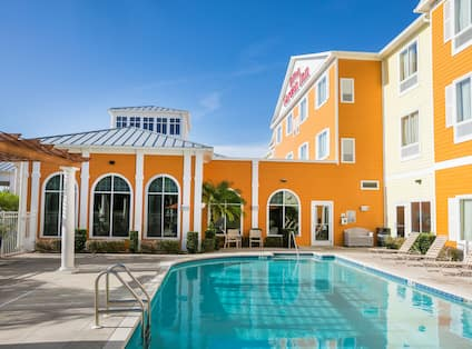 Outdoor Swimming Pool with Hotel Building in Background