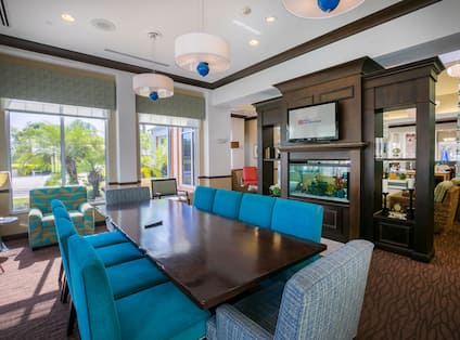 Lobby Seating Area with Chairs, Table, Fish Tank and Wall Mounted HDTV