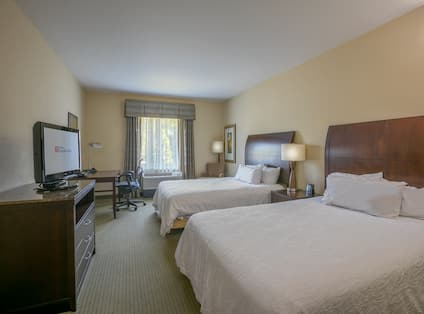 Two Queen Beds Guest Bedroom with HDTV and Work Desk