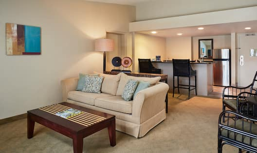 Suite Living Area with Couch, Coffee Table, Bar Counter and Kitchen Area