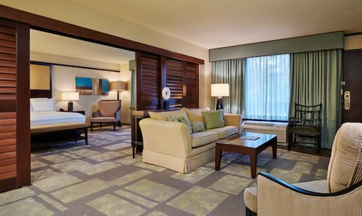 Suite Living Room with Lounge Seating, Coffee Table and Entry to Bedroom