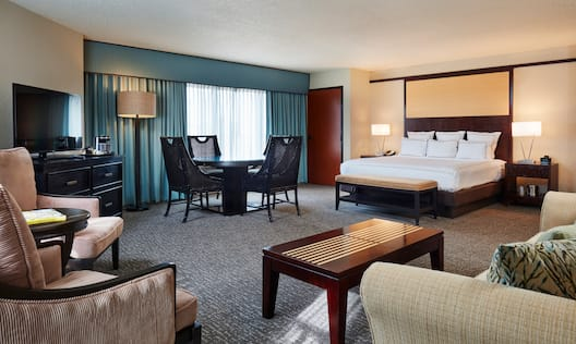Junior Suite with King Bed, Lounge Seating, Television, Tables and Chairs