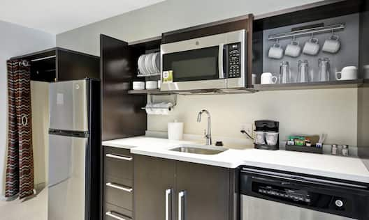 Guest Room Kitchen with Stainless Steel Appliances