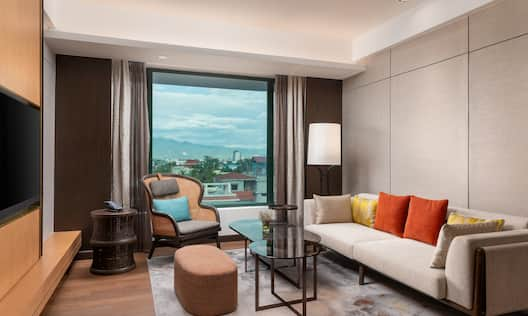 Living Room Area in Suite with City View