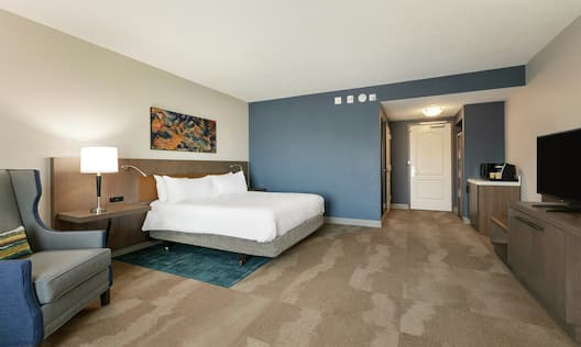 Accessible King Guestroom with Bed, Lounge Area, and Room Technology