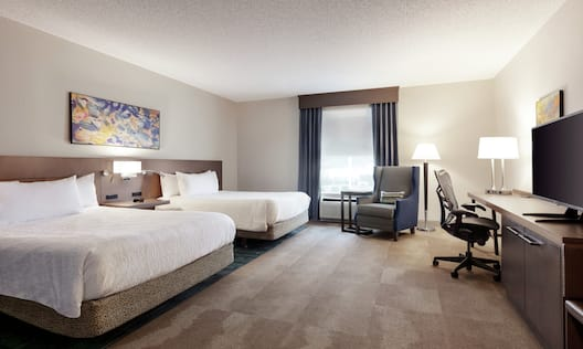 Accessible Guestroom with Two Queen Beds, Lounge Area, Work Desk, and Room Technology