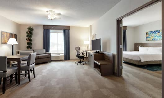 King Suite with Bed, Lounge Area, Work Desk, Room Technology, and Dining Area