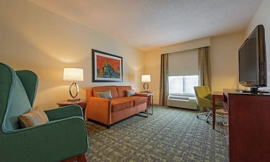 Guestroom Suite with Lounge Area, Work Desk, and Room Technology