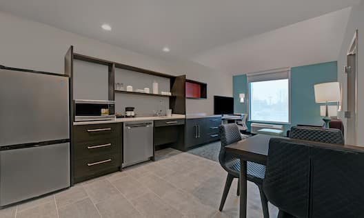 guest room showing kitchen and lounge area with window
