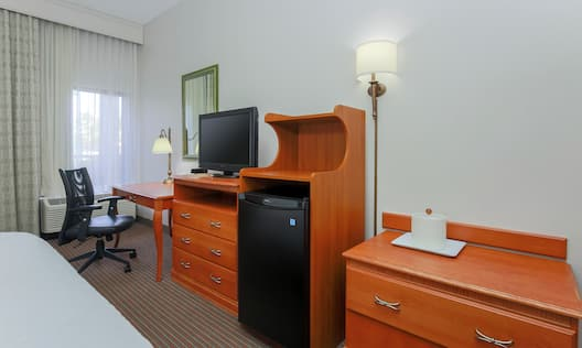 Guest Room with HDTV, Work Desk, and Refrigerator