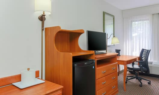 Guest Room with Mini Refrigerator, HDTV, and Work Desk