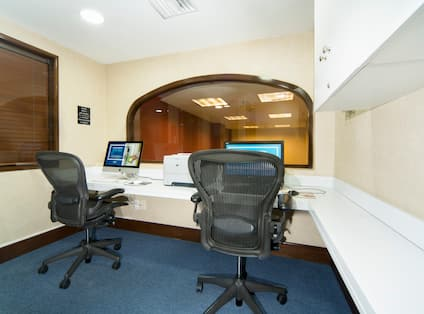 Business Center with Two Desktop Computers, Two Office Chairs and Printer
