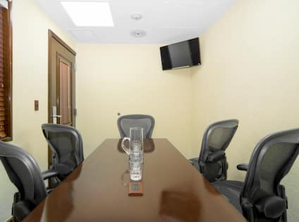 Boardroom with Meeting Table, Office Chairs and Wall Mounted HDTV