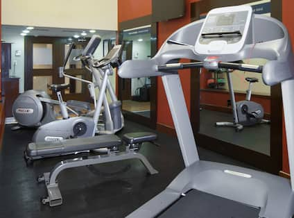 Fitness Center with Treadmill, Weight Bench, Cross-Trainer and Cycle Machine