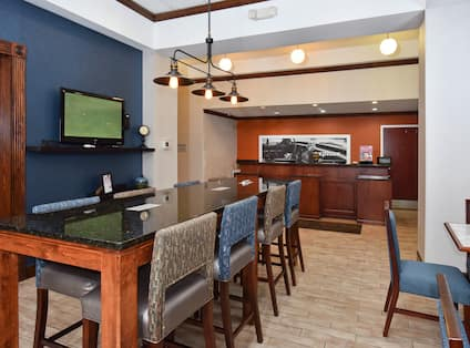 Front Desk Reception Area with Tall Table and Tall Chairs