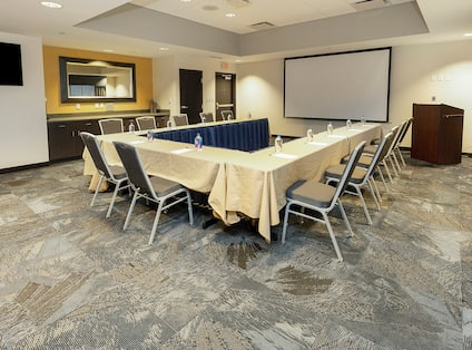 Meeting Room with U-Shape Table Layout and Projector Screen